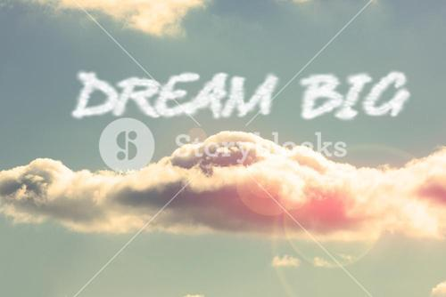 Dream big against bright blue sky with cloud