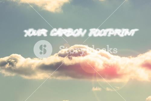 Your carbon footprint against bright blue sky with cloud