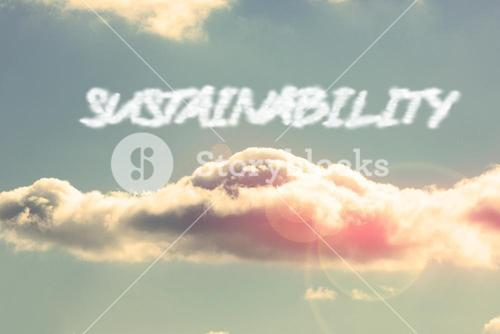 Sustainability against bright blue sky with cloud