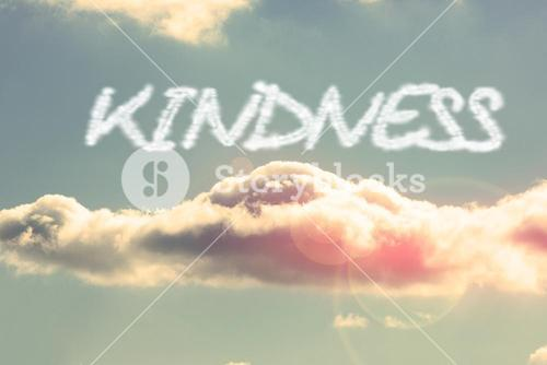 Kindness against bright blue sky with cloud