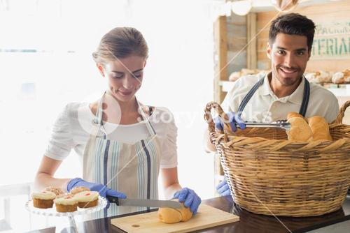 People with croissants at coffee shop counter