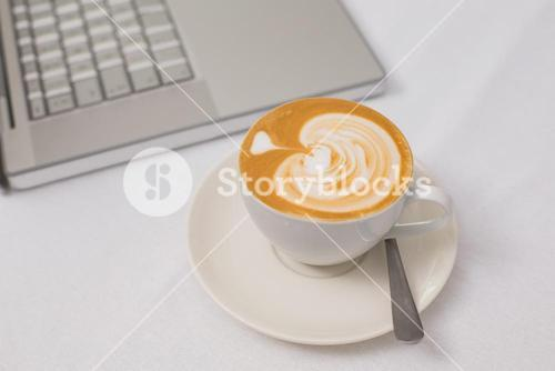 Coffee and laptop on table