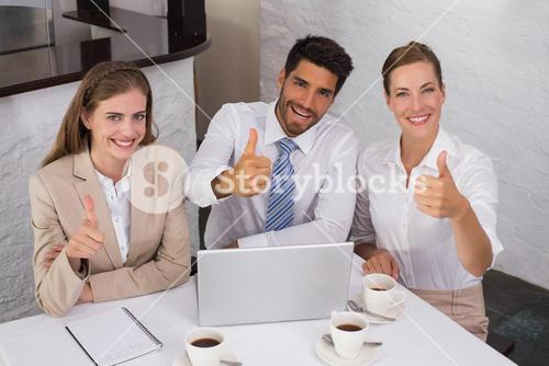 Business people gesturing thumbs up