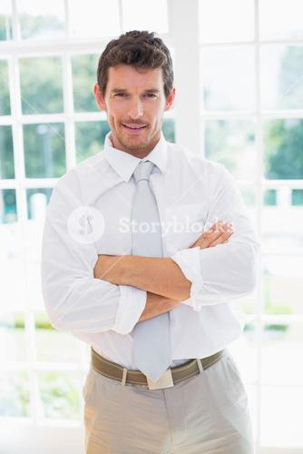 Smart businessman with hands folded at home