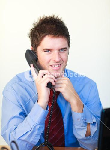 Handsome businessperson talking on the phone