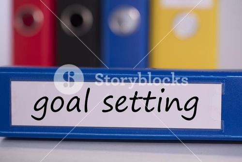 Goal setting on blue business binder