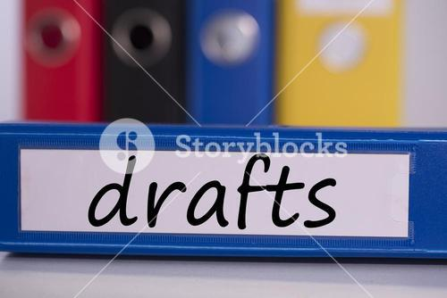 Drafts on blue business binder