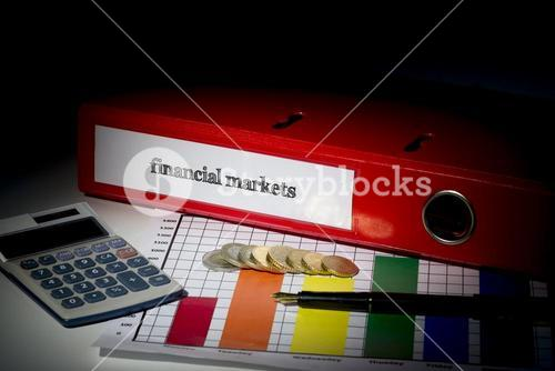 Financial markets on red business binder