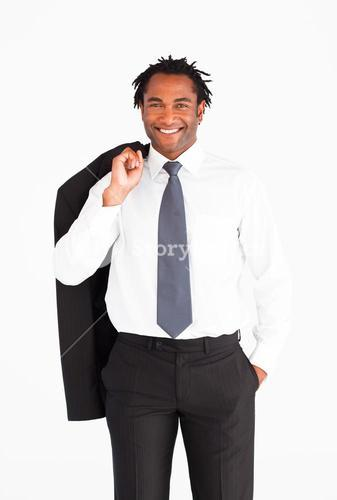 Smiling welldressed businessman looking at the camera