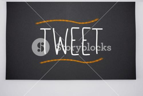 Tweet written on big blackboard