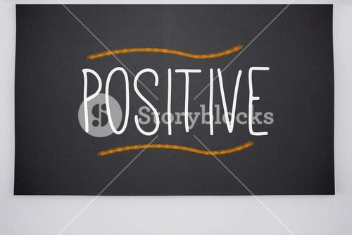 Positive written on big blackboard