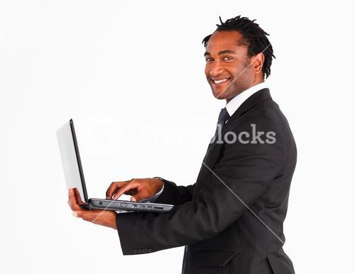 Closeup of businessman working on laptop