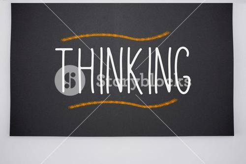 Thinking written on big blackboard
