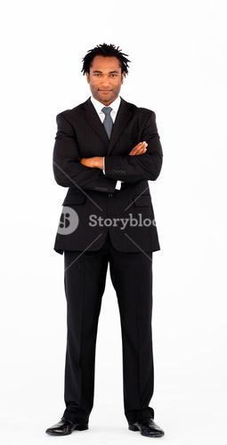 Serious businessman with folded arms