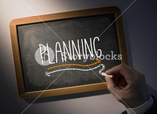 Hand writing Planning on chalkboard