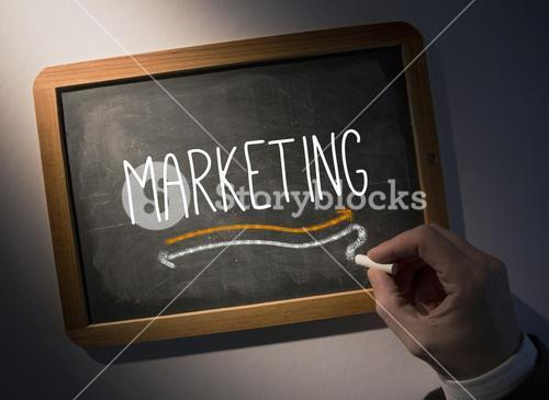 Hand writing Marketing on chalkboard