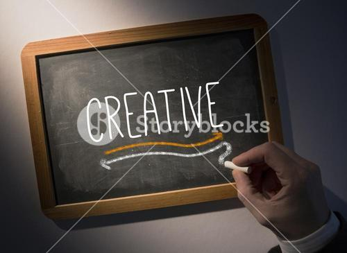 Hand writing Creative on chalkboard