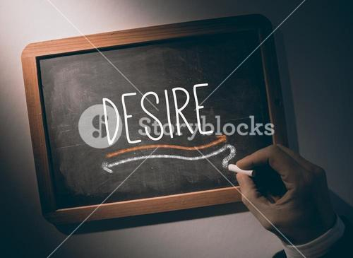 Hand writing Desire on chalkboard