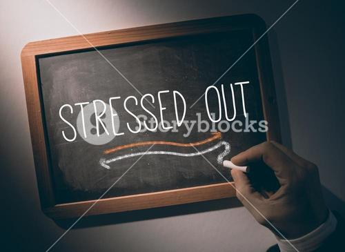 Hand writing Stressed out on chalkboard