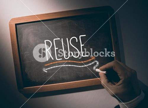 Hand writing Reuse on chalkboard