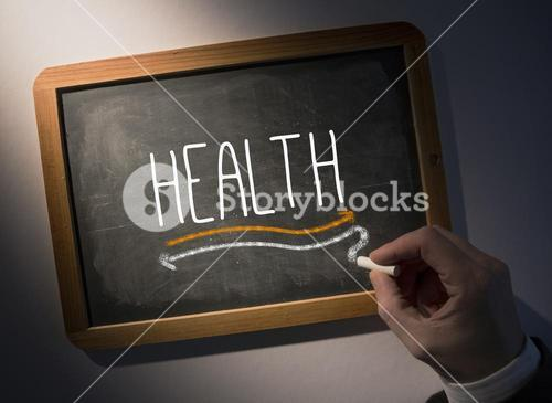 Hand writing Health on chalkboard