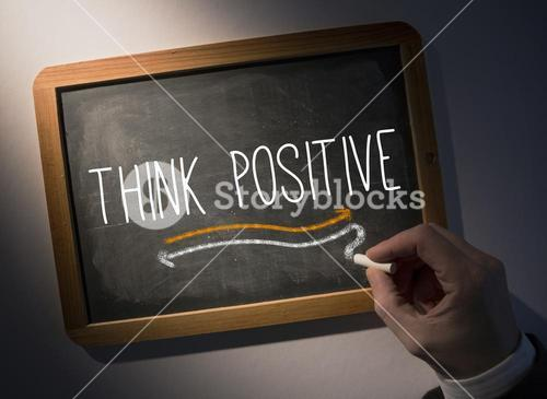 Hand writing Think positive on chalkboard