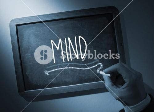 Hand writing Mind on chalkboard