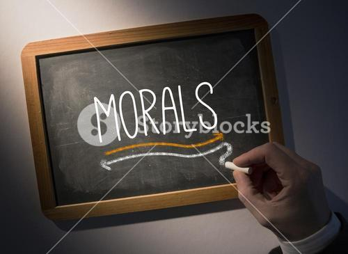 Hand writing Morals on chalkboard