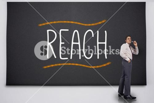 Businessman turning away from the word reach