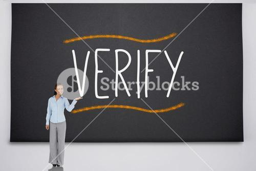 Businesswoman presenting the word verify