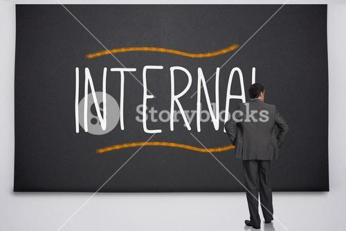 Businessman reading the word internal