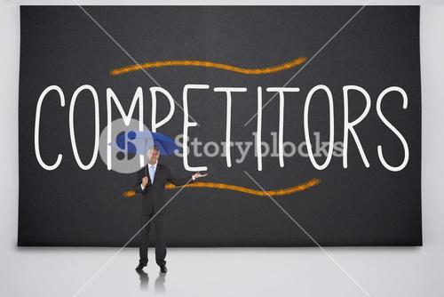 Businessman holding umbrella against the word competitors
