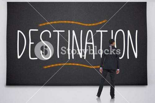 Businessman reading the word destination