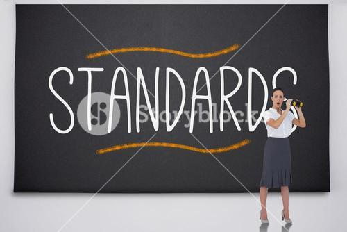 Shocked businesswoman with binoculars against the word standards