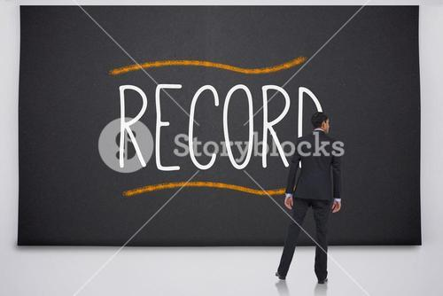 Businessman reading the word record