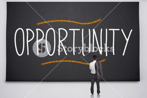 Businessman reading the word opportunity
