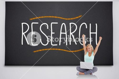 Cheering blonde with laptop against the word research