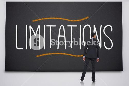 Businessman reading the word limitations