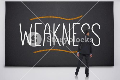 Businessman reading the word weakness