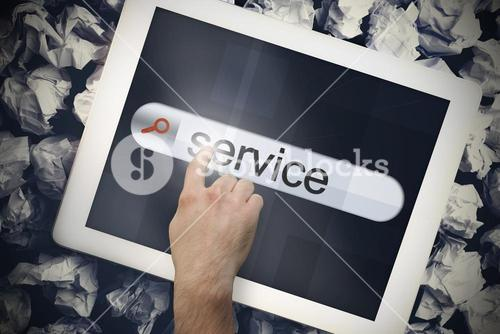 Hand touching service on search bar on tablet screen