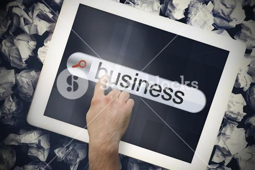 Hand touching business on search bar on tablet screen