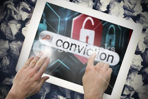 Hand touching conviction on search bar on tablet screen