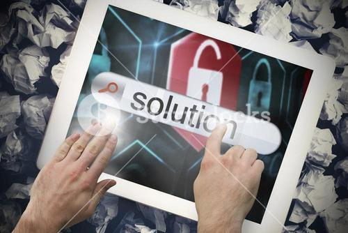 Hand touching solution on search bar on tablet screen