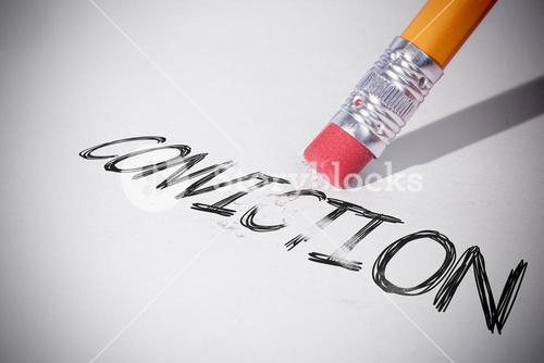 Pencil erasing the word Conviction