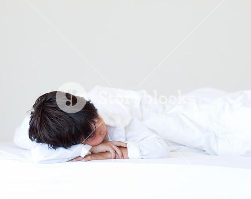 Kid sleeping in a bed
