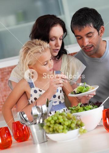 Cheerful family preparing food together