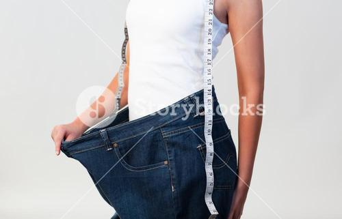 Close up of woman wearing big jeans focus on woman