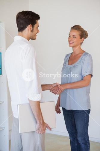Casual business people shaking hands
