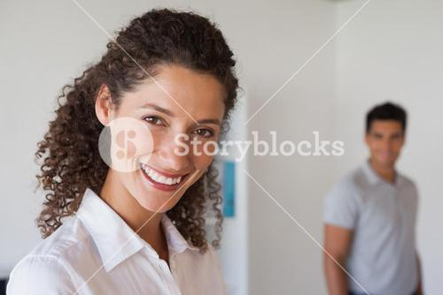 Casual business partners smiling at camera
