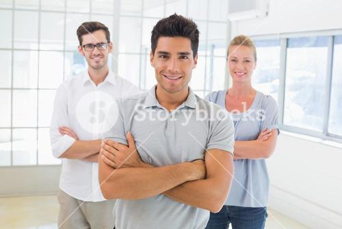 Casual business team smiling at camera